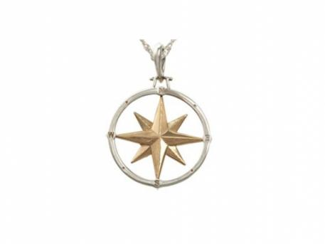 "Large Compass Rose Pendant - Large SS/14k Compass Rose Pendant. Measures just over 1"" across.For a thousand years travelers have relied on a compass in hand and as an icon beautifully drawn on their maps, to guide them to their destination.  Wear this Compass Rose as a talisman to remind you that we are not just travelers but the navigators of our destiny.Made here in Massachusetts."